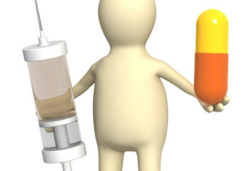 3d puppet with pill and syringe. Isolated over white